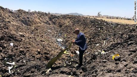 Ethiopian Airlines issued this image on their official facebook page. Pictured, the CEO visiting the crash site
