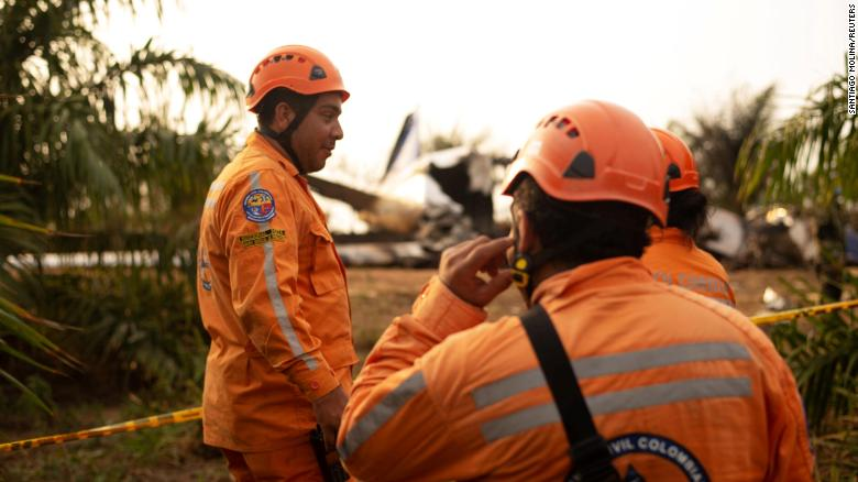 Members of the Colombian civil defense work where a plane crashed.