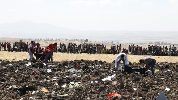 Rescue team collect remains of bodies amid debris at the crash site of Ethiopia Airlines near Bishoftu, a town some 60 kilometres southeast of Addis Ababa, Ethiopia, on March 10, 2019. - An Ethiopian Airlines Boeing 737 crashed on March 10 morning en route from Addis Ababa to Nairobi with 149 passengers and eight crew believed to be on board, Ethiopian Airlines said. (Photo by Michael TEWELDE / AFP)        (Photo credit should read MICHAEL TEWELDE/AFP/Getty Images)
