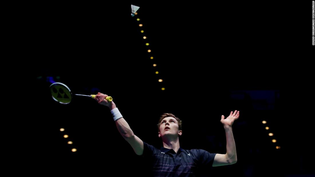 Denmark's Viktor Axelsen plays a shot during the men's final match of the All England Open Badminton Championships against Japan's Kento Momota at Arena Birmingham on Sunday, March 10.