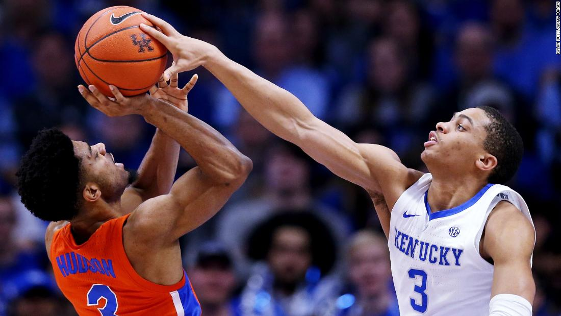 University of Kentucky guard Keldon Johnson blocks a shot attempt by Jalen Hudson of the Florida Gators in the first half of an NCAA basketball game on Saturday, March 9, in Lexington, Kentucky.