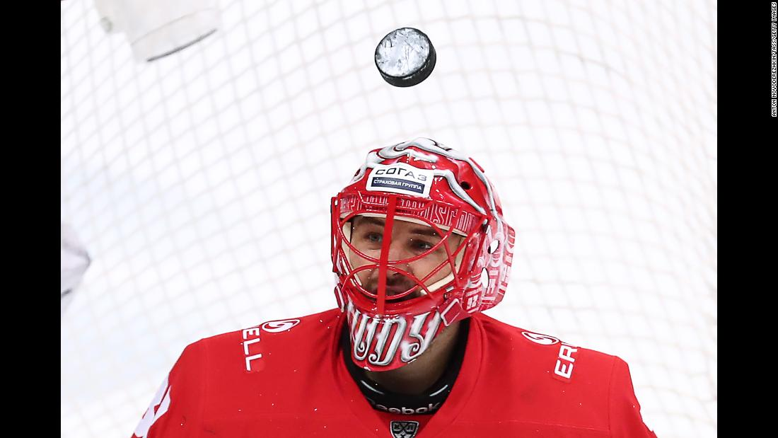 A puck soars over goalie Julius Hudacek of Spartak Moscow during the Western Conference quarterfinal game between Spartak Moscow and SKA Saint Petersburg in Moscow, Russia on Friday, March 8.