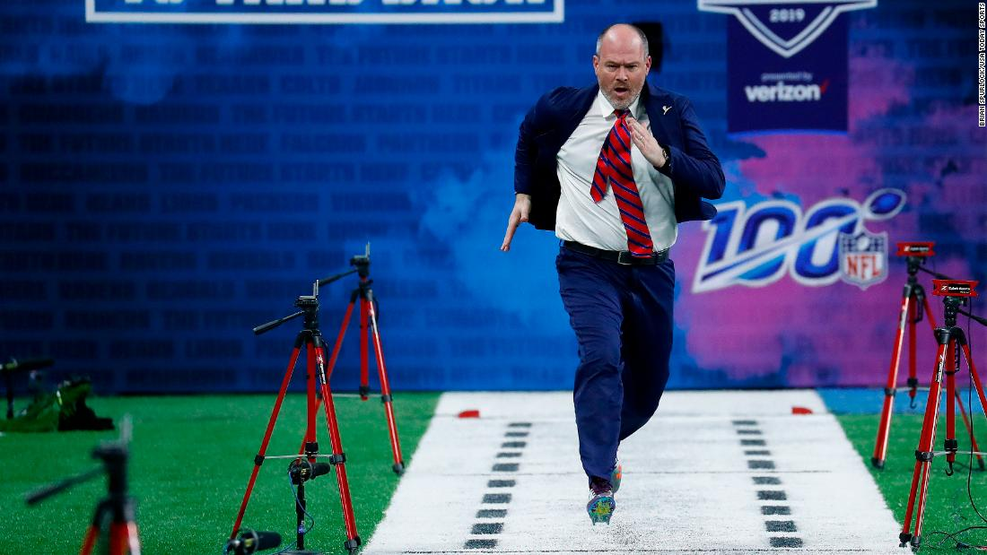 NFL Network announcer Rich Eisen runs the 40-yard dash during the NFL Combine at Lucas Oil Stadium on Sunday, March 3. Eisen, who has run in the combine for the past several years, has turned the humorous stunt into a way to raise money for St. Jude Children's Research Hospital.
