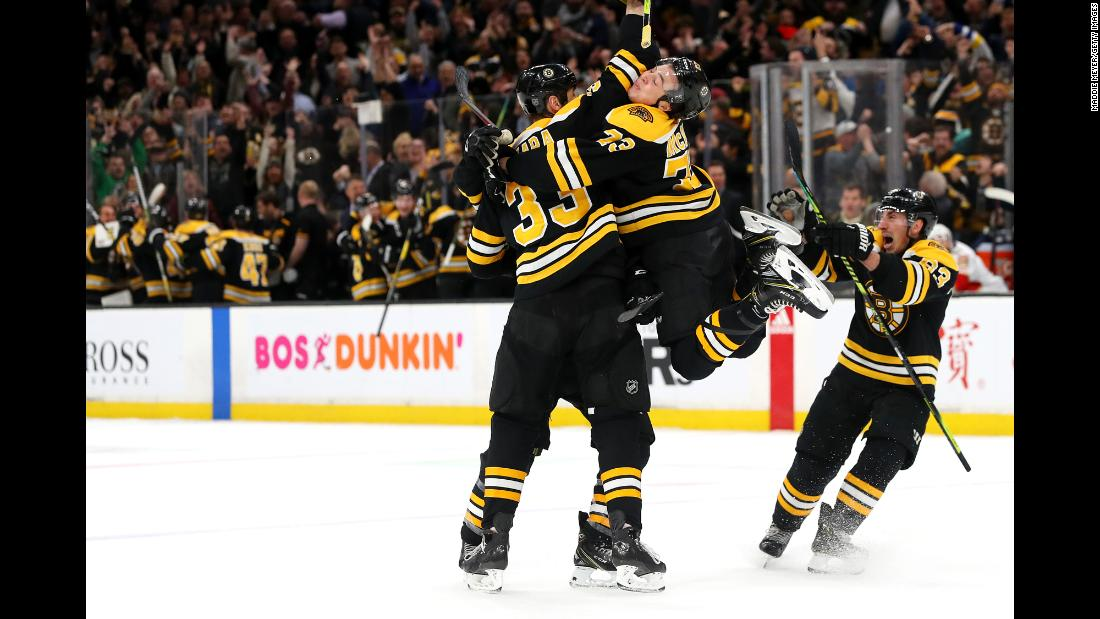 From left, Zdeno Chara, Charlie McAvoy and Brad Marchand of the Boston Bruins celebrate with Patrice Bergeron after he scored the game winning goal during an NHL game against the Florida Panthers on Thursday, March 7 at TD Garden.