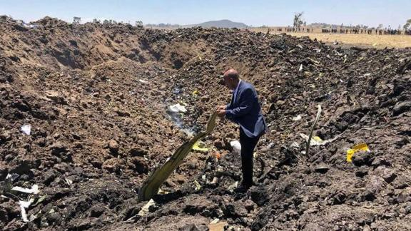 Editorial use only. HANDOUT /NO SALESMandatory Credit: Photo by Ethiopia Airlines/HANDOUT/EPA-EFE/REX/Shutterstock (10149794a)A handout photo made available by Ethiopia Airlines shows the Ethiopian carrier's CEO Tewolde GebreMariam posing among debris at the crash site of Ethiopian Airlines Boeing 737 Max 8 en route to Nairobi, Kenya, crashed near Bishoftu, Ethiopia, 10 March 2019. All passengers onboard the scheduled flight ET 302 carrying 149 passengers and 8 crew members, have died, the airlines says.Ethiopian Airlines plane en route from Addis Ababa to Nairobi crashed, Bishoftu, Ethiopia - 10 Mar 2019
