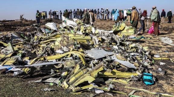 A crowd gathers near debris at the crash site of Ethiopian Airlines Flight ET302 on Monday, March 11.