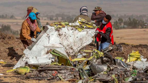 People work at the crash site on March 11.
