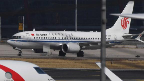 An Air China Boeing 737 MAX 8 plane is seen at Beijing Capital Airport on March 11, 2019. - China on March 11, 2019 ordered domestic airlines to suspend commercial operation of the Boeing 737 MAX 8, citing the Ethiopian Airlines crash and another deadly accident of that same model in Indonesia. (Photo by GREG BAKER / AFP)        (Photo credit should read GREG BAKER/AFP/Getty Images)