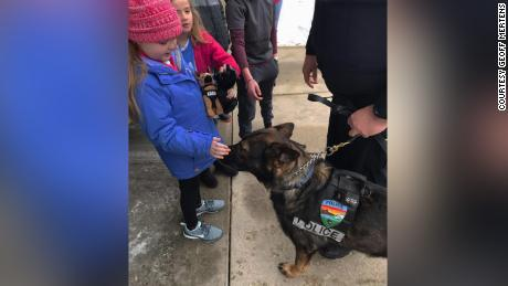 Emma Mertens was excited to meet nearly 40 police dogs who showed up on her doorstep on Saturday morning.