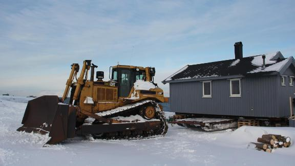 Christiane Hubner's hut is loaded onto the sled that will transport it to inland to a safe location.