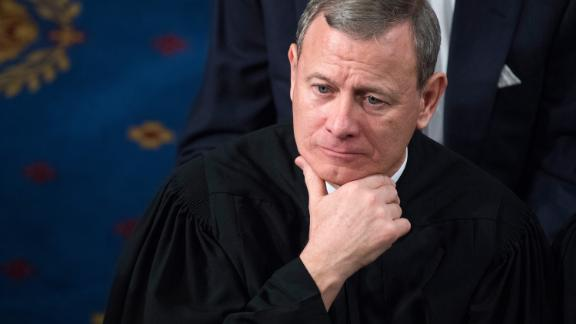 Supreme Court Chief Justice John Roberts listens to President Donald Trump