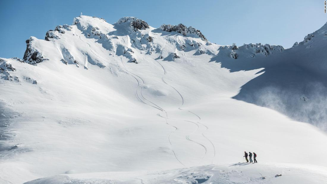 Beneath the summit, the skiers found an untouched, snow-filled scene.