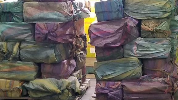 Sixty packages were removed from the container and are under investigation by authorities.