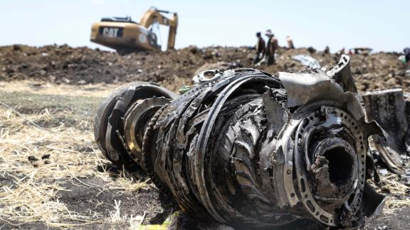 A photo shows debris of the crashed airplane of Ethiopia Airlines, near Bishoftu, a town some 60 kilometres southeast of Addis Ababa, Ethiopia, on March 11, 2019. - Airlines in Ethiopia, China and Indonesia grounded Boeing 737 MAX 8 jets Monday as investigators recovered the black boxes from a brand-new passenger jet that crashed outside Addis Ababa a day earlier, killing all 157 people on board. (Photo by Michael TEWELDE / AFP)        (Photo credit should read MICHAEL TEWELDE/AFP/Getty Images)