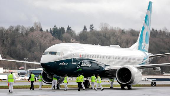 SEATTLE, WA - JANUARY 29: Members of the ground crew check out a Boeing 737 MAX 8 airliner after it landed at Boeing Field to complete its first flight on January 29, 2016 in Seattle, Washington. The 737 MAX is the newest generation of Boeing's most popular airliner featuring more fuel efficient engines and redesigned wings. (Photo by Stephen Brashear/Getty Images)