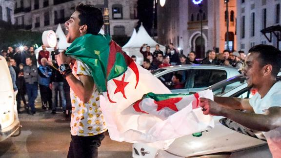 Algerians celebrate on the streets after Bouteflika announced he would not stand for a fifth term.