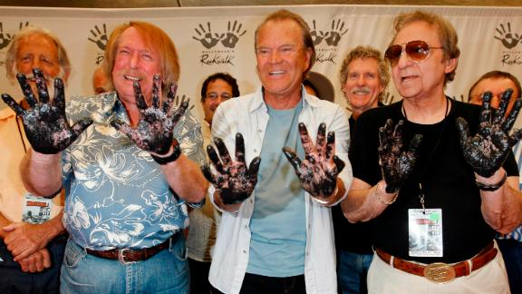 """""""The Wrecking Crew's"""" Don Randi, from left, Glen Campbell and Blaine are inducted into RockWalk in 2008."""