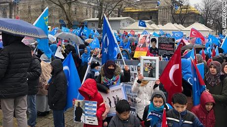 Demonstrators wave Uyghur nationalist flags in central Istanbul as they hold up photos of missing relatives caught up in China's crackdown on the Uyghur minority group.