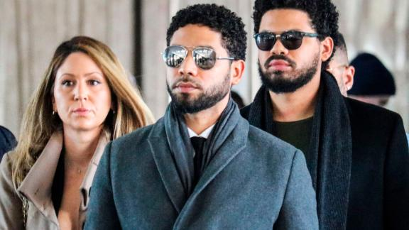 "Actor Jussie Smollett(C) and team arrive for a court hearing at the Leighton Criminal Courthouse on March 12, 2019 in Chicago. - A Chicago grand jury on March 8, 2019 indicted American actor Jussie Smollett on 16 felony counts after allegedly lying to police about being the victim of a racist, homophobic hate crime. Police say Smollett -- who gained fame on Fox musical drama ""Empire"" -- staged the attack in a bid to gain publicity and a bigger paycheck. (Photo by DEREK HENKLE / AFP)        (Photo credit should read DEREK HENKLE/AFP/Getty Images)"