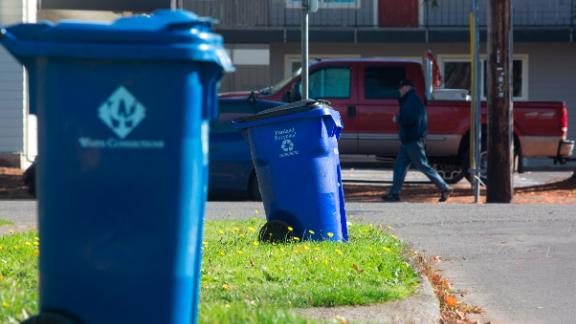 Blue recycling bins are seen on a residential street in Portland, Oregon. Coca-Cola will use learnings from its Atlanta program to help scale its recycling efforts.