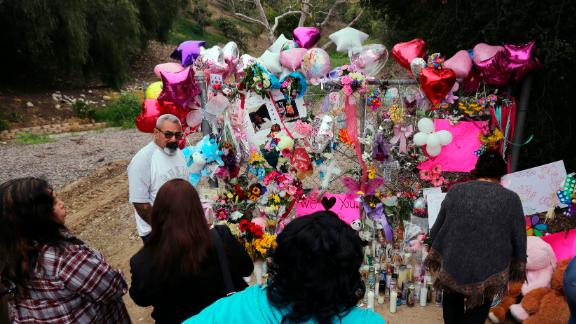 People gathered at a large memorial honoring the 9-year-old girl on Monday.