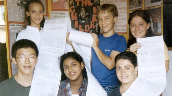 June 1995, and early efforts at advocacy work against child labor. Craig Kielburger (back row, center) with some of the original members of WE, who gathered 3,000 signatures.