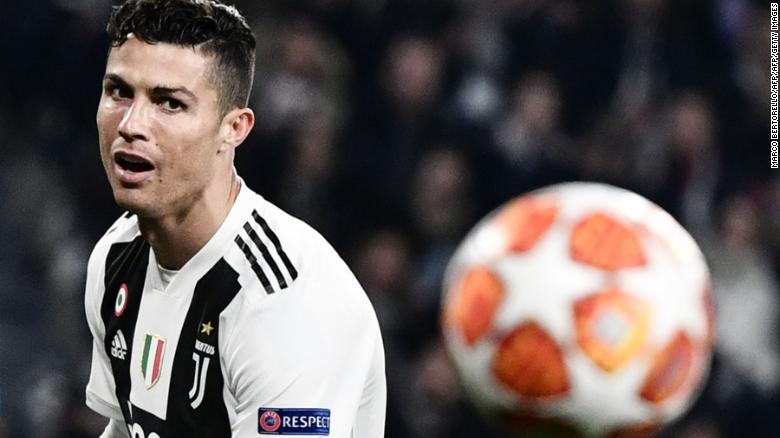 f5e2926ccbcda Juventus  Portuguese forward Cristiano Ronaldo eyes the ball during the  UEFA Champions League round of