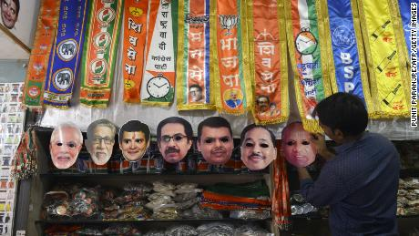 An Indian shopkeeper puts up face masks of political leaders at a shop in Mumbai on March 12, 2019. - India on March 10 announced a general election to be held over nearly six weeks starting on April 11, when hundreds of millions of voters will cast ballots in the world's biggest democracy. (Photo by Punit PARANJPE / AFP)        (Photo credit should read PUNIT PARANJPE/AFP/Getty Images)
