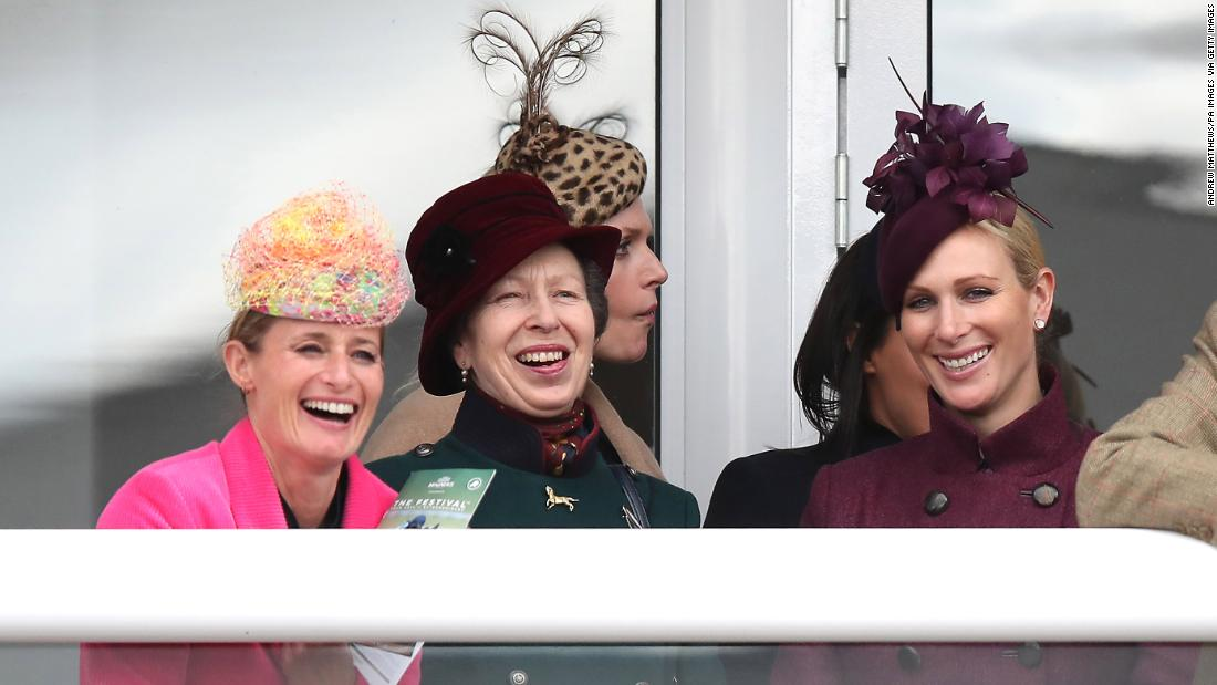 The Princess Royal (center) and Zara Tindall (right) watch the action during Ladies Day of the 2019 Cheltenham Festival.