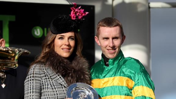 Actress and model Liz Hurley presented Walsh with the winning trophy by  at Cheltenham.