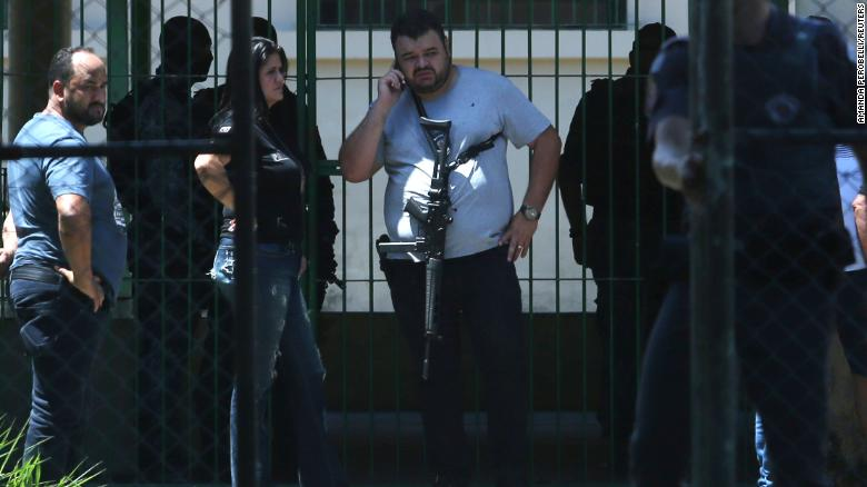 Police officers at the Raul Brasil school in Suzano, Brazil, after a shooting Wednesday.