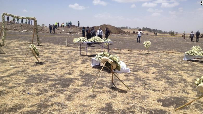 Tributes and offerings for the victims of Ethiopian Airlines flight 302 are seen at the crash site.