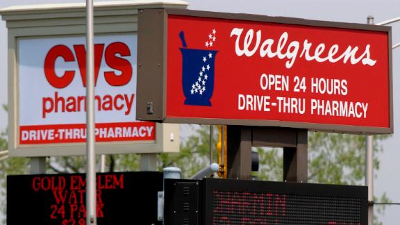 A Walgreens and CVS drugstore are seen on adjacent corners at an intersection in Calumet City, Ill., on Friday, April 30, 2004. In April, a deal to buy 1,260 Eckerd stores put CVS in the lead with total number of stores nationwide and left the two chains virtually deadlocked in sales. Despite that deal, analysts still say Walgreens is winning the drugstore war. (AP Photo/M. Spencer Green)