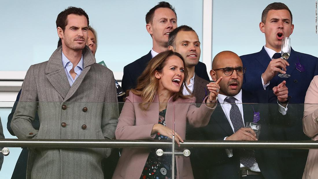 Tennis star Andy Murray and his wife Kim Murray watch the opening race on Ladies Day at the 2019 Cheltenham Festival.