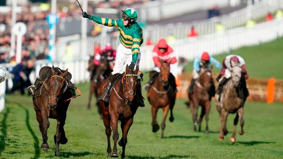 Jockey Mark Walsh rode Espoir D'Allen to win the feature Champion Hurdle on the opening day of the 2019 Festival.