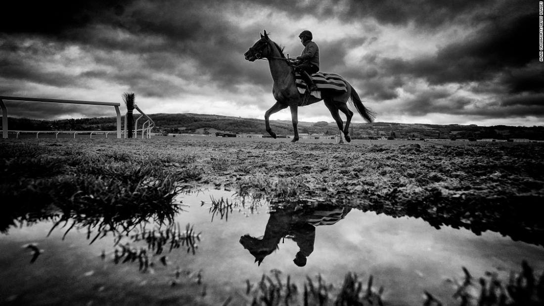 Rain sits in puddles on the all-weather surface of the Cheltenham gallops ahead of the Festival. (Digital filters were used in this image)