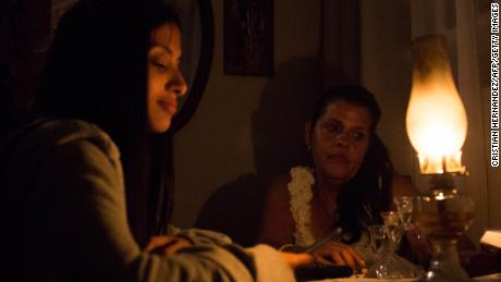 Venezuelan Yadira Delgado and her daughter Vanesa remain at their home in Caracas on March 9, 2019, during a massive power outage.