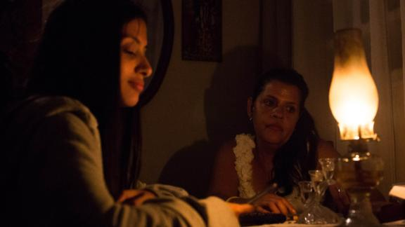 Venezuelan Yadira Delgado and her daughter Vanesa remain at their home in Caracas on March 9, 2019, during a massive power outage. - Sunday is the third day Venezuelans remain without communications, electricity or water, in an unprecedented power outage that already left 15 patients dead and threatens with extending indefinitely, increasing distress for the severe political and economic crisis hitting the oil-rich South American nation.
