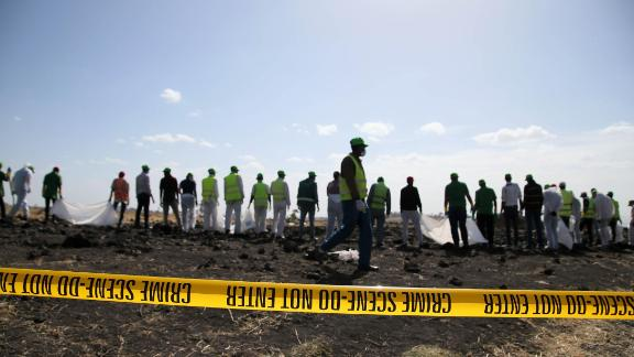 BISHOFTU, ETHIOPIA - MARCH 12:  Forensics investigators and recovery teams collect personal effects and other materials from the crash site of Ethiopian Airlines Flight ET 302 on March 12, 2019 in Bishoftu, Ethiopia. All 157 passengers and crew perished after the Ethiopian Airlines Boeing 737 Max 8 Flight came down six minutes after taking off from Bole Airport in Addis Ababa.  (Photo by Jemal Countess/Getty Images)