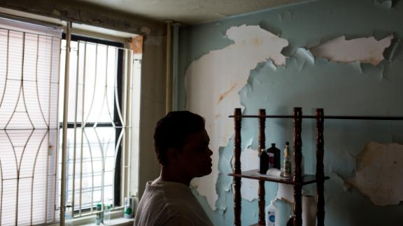 Montanez stands in her damaged apartment in Queensbridge Houses.