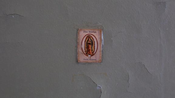 An image of the Virgin Mary adorns a wall in the damaged apartment of Miriam Montanez.