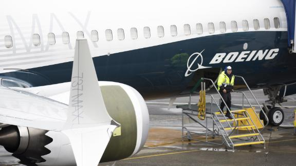 "A worker is pictured next to a Boeing 737 MAX 9 airplane on the tarmac at the Boeing Renton Factory in Renton, Washington on March 12, 2019. - US President Donald Trump on March 13, 2019, announced a plan to ground all Boeing 737 MAX aircraft amid intense international and political pressure following the second deadly crash in less than five months. ""We"