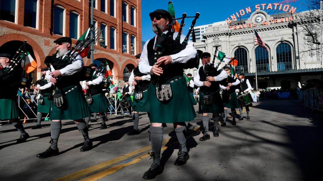 <strong>Denver:</strong> The Michael Collins Pipe & Drums band heads up 17th Avenue at the start of the 2018 parade.