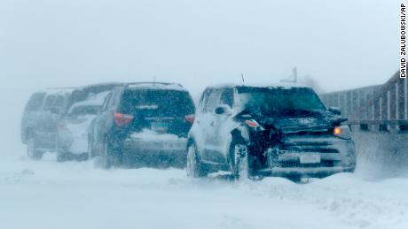 A string of wrecked vehicles sit on an overpass over Interstate 70 as a late winter storm packing hurricane-force winds and snow sweeps over the intermountain West Wednesday, March 13, 2019, in Aurora, Colo . (AP Photo / David Zalubowski)