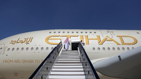 FILE: An attendee enters an Airbus SE A380 passenger aircraft, operated by Etihad Airways PJSC, during the 15th Dubai Air Show at Dubai World Central (DWC) in Dubai, United Arab Emirates, on Monday, Nov. 13, 2017. Airbus SE decided to stop making the A380 double-decker after a dozen years in service, burying a prestige project that won the hearts of passengers and politicians but never the broad support of airlines that instead preferred smaller, more fuel-efficient aircraft. Production of the jumbo jet will end by 2021, after the A380s biggest customer, Emirates, and a handful of remaining buyers receive their last orders. Photographer: Natalie Naccache/Bloomberg via Getty Images