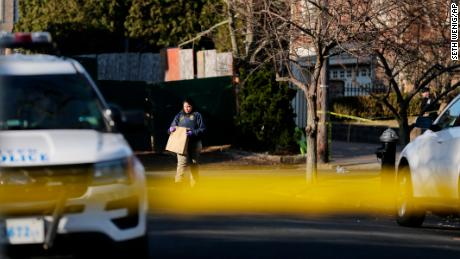 Police on Thursday work near the scene where Cali was killed on Staten Island.