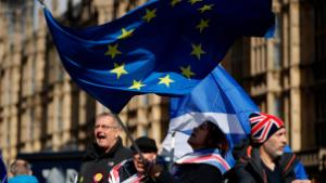 Anti-Brexit remain in the European Union supporters shout slogans during a protest outside the Houses of Parliament in London, Thursday, March 14, 2019. British lawmakers faced another tumultuous day Thursday, as Parliament prepared to vote on whether to request a delay to the country's scheduled departure from the European Union and Prime Minister Theresa May struggled to shore up her shattered authority. (AP Photo/Matt Dunham)
