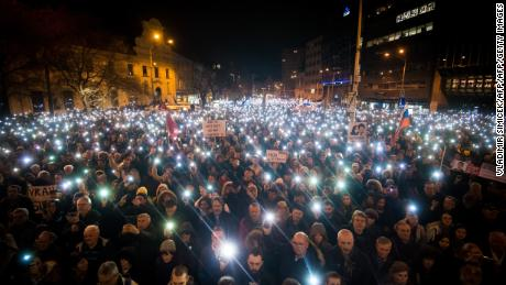 Thousands of Slovaks attend a protest in Bratislava on the first anniversary of the murder.