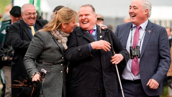 Owner Andrew Gemmell, who was born blind, celebrates with trainer Emma Lavelle (left) as his horse Paisley Park wins the feature Stayers Hurdle on St Patrick's Thursday at Cheltenham.