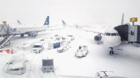 NEW YORK, NY - JANUARY 04:  JetBlue airplanes wait at the gates outside terminal five at John F. Kennedy International Airport on January 4, 2018 in the Queens borough of New York City. A winter storm is traveling up the east coast of the United States dumping snow and creating blizzard like conditions in many areas. (Photo by Rebecca Butala How/Getty Images)